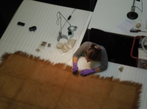 2nd year student Emma Schmitt conserving a plaited mat at the Pitt Rivers Museum. © Pitt rivers Museum, University of Oxford