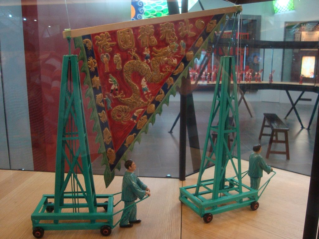 A model of the dragon banner being paraded