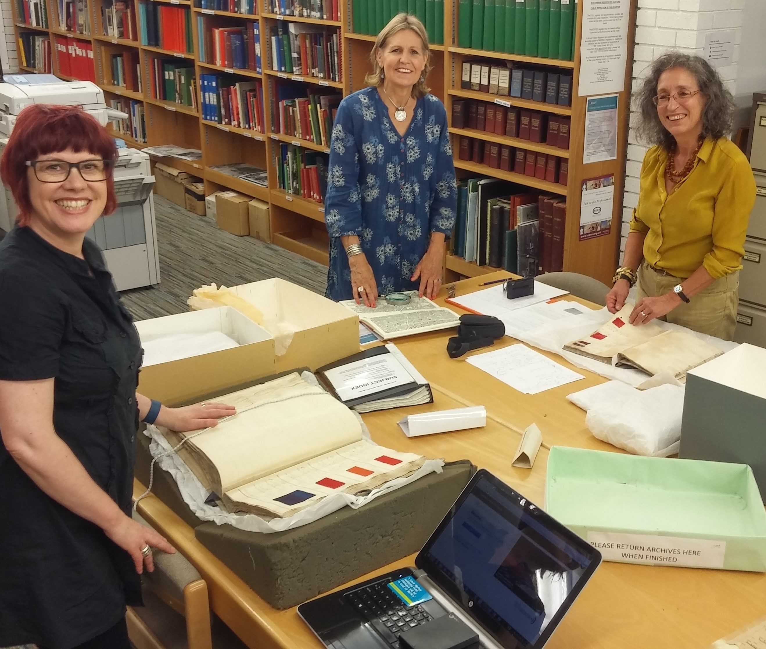 Anita, Jenny Balfour-Paul and Dominique Cardon examining the early 18th C. Crutchley Archive of dyeing manuals at Southwark Local History Library and Archive 2