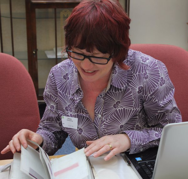 Anita examining 19th c. dyeing manuals at the Bradford College of Textiles Archive